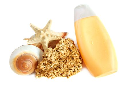 coquina: A bottle of suntan lotion and shell, starfish and coquina rock on white background