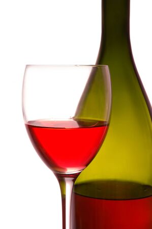 Red wine and green bottle on whit background photo