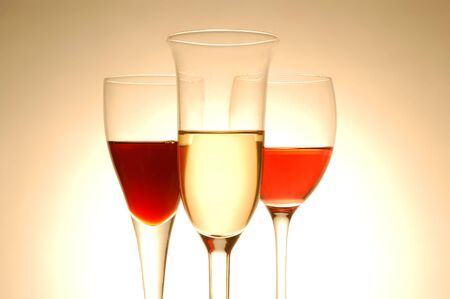 Various wine glasses on yellow background photo