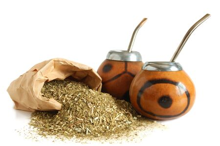 mate drink: �ups from calabash and straws with dry mate leaves - traditional drink of Argentina. Stock Photo