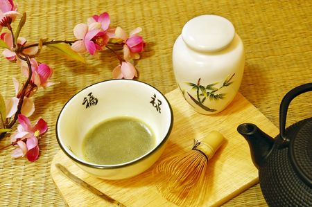 Tools used for Japanese tea ceremony (chado). A brush made of bamboo and a teacup with green tea called matcha on wooden tray. photo