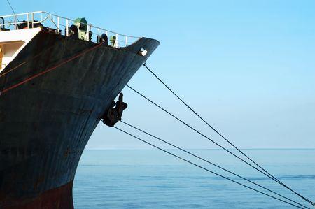 docked: Cargo ship docked in sea port