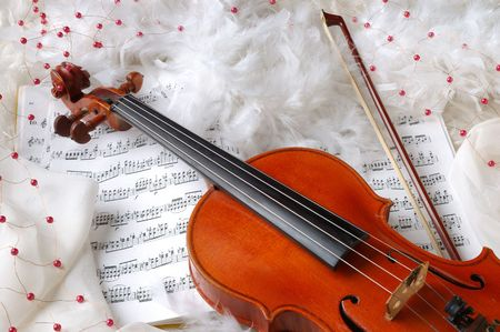 Violin and notes on white silk background with boa and furs Stock Photo - 5042493