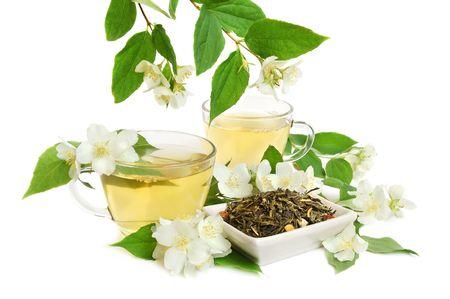 jasmine flower: Organic jasmine tea leaves with fresh jasmine flowers and cups of tea on white background Stock Photo