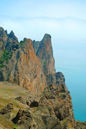 Beautiful view of the cliff and sea in Kara Dag reserve in Crimea, Ukraine. photo