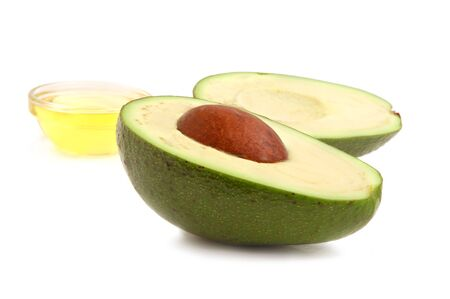 Avocado and vegetable oil on white background photo