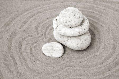 raked: White stones on raked sand