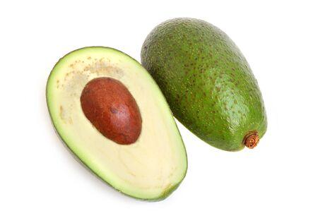 Avocado cut in half on white background photo