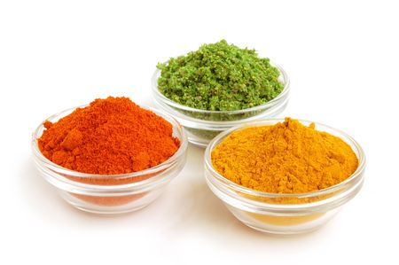 colored powder: Piles of spices. Parsley, oregano, red paprika and curcuma. Stock Photo