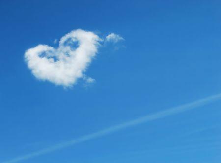 Cloudscape heart shape in sky photo