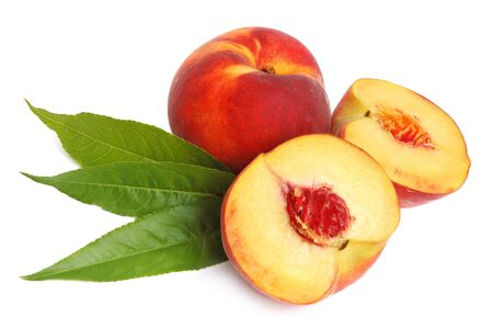 Ripe peach and a half with leaves on a white background photo