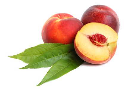 Ripe peach and a half with leaves on a white background Stock Photo - 5731094