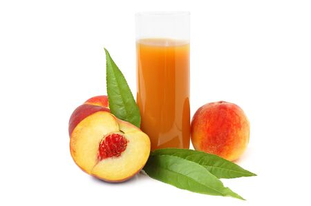 Glass with freshly made peach juice and leaves on a white background photo