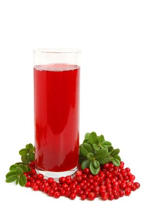 Glass with freshly fruit drink made from cranberries and leaves on a white background