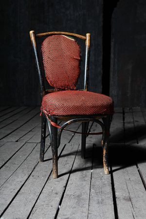 Old fashioned chair on wooden floor Stock Photo - 5731323