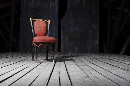 Old fashioned chair on wooden floor Stock Photo - 5731312