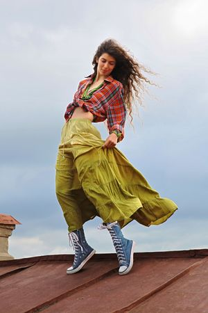 Young female dancing on a iron roof photo