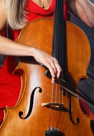 Close up of a cello musician on dark background photo