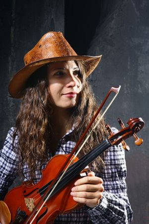 Beautiful violinist country performer on black background photo