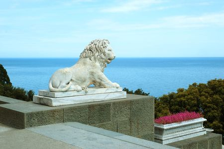 alupka: One of the lions outside of the Vorontsovsky Palace in the town of Alupka, Crimea, Ukraine. A summer residence of the governor-general of the Novorossiysky Krai, Prince Mikhail Semyonovich Vorontsov.
