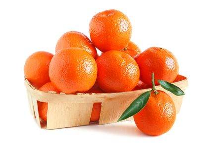 Sweet juice tangerines in basket on white background Stock Photo - 6425432