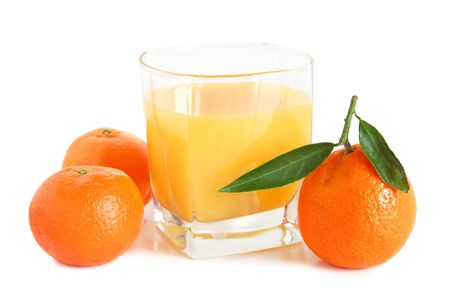 Sweet tangerines juice in glass on white background photo