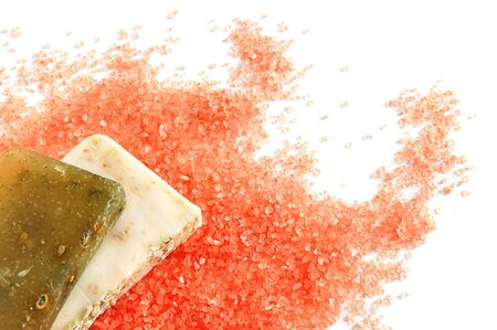 Natural handmade soaps on pink salt background photo