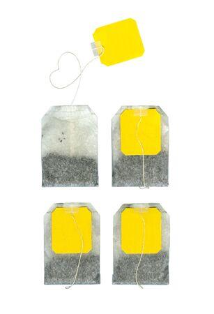 Four teabags on white background photo