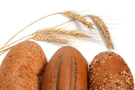 shafts: Homemade whole bread and shafts of wheat on a white background Stock Photo