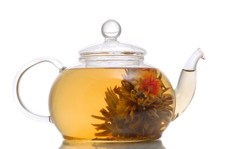 Glass teapot with blooming flower green tea on white background Stock Photo