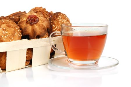 Tea and cookies in a basket on white background Stock Photo