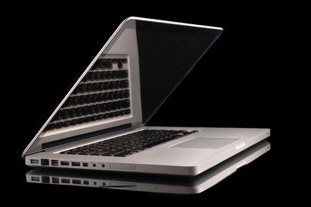 Aluminium laptop with desktop on black background photo