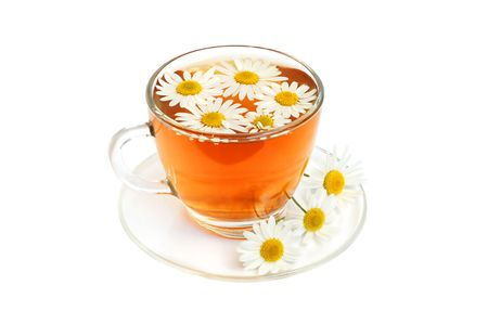 Herbal camomile tea on a white background photo