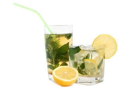 Mojito cocktail or iced tea with lemon, mint leaves and ice on white background photo
