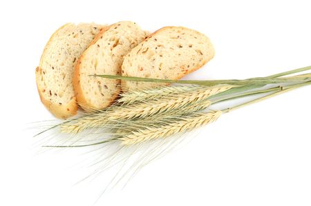 Homemade sliced wheat bread on a white background photo