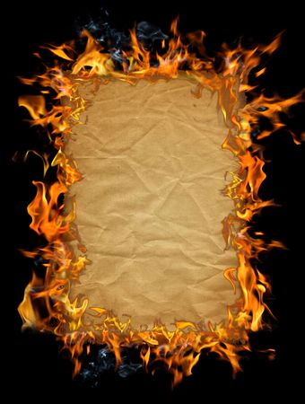 Old paper texture on fire against a dark background photo