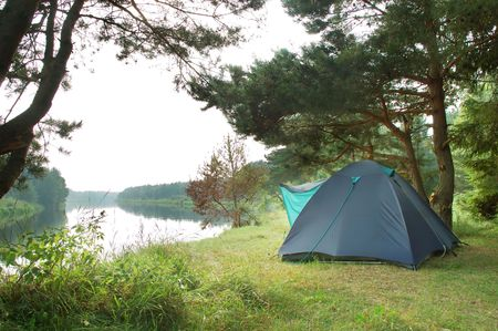 Tourist camping in the wilderness at the river Stock Photo - 7936555