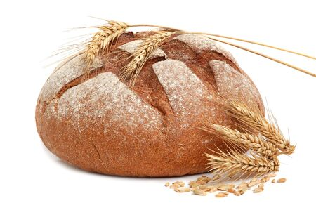 Homemade whole bread and stalks of wheat on a white background Stock Photo