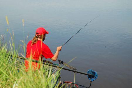 Fisherman on a beautiful river photo