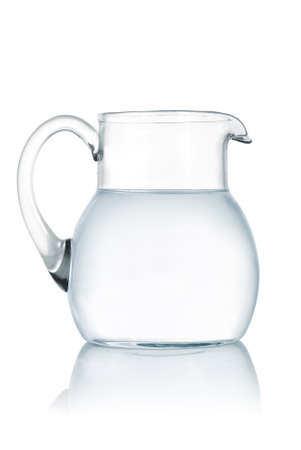 Glass jug with fresh water on white background photo