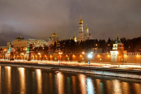 Moscow, Russia, February 07, 2011. Panorama of Moscow Kremlin and Moskva river in a winter night. Bbright illumination of Kremlin wall, towers and orthodox church.  photo