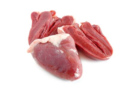 giblets: Raw turkey hearts on a white background
