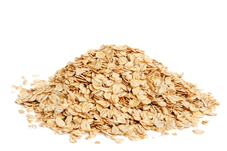 Oat flakes on white background Stock Photo - 9923222