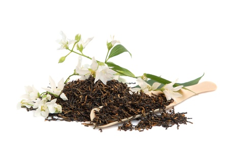 Tea leaves with fresh jasmine flowers and spoon on white background Stock Photo