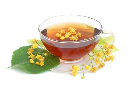 linden tea: Linden tea with fresh linden flowers on a white background Stock Photo