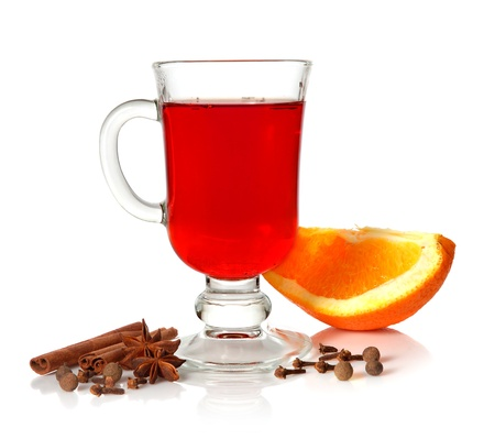 Hot mulled wine in glass cup and spice on white background Stock Photo