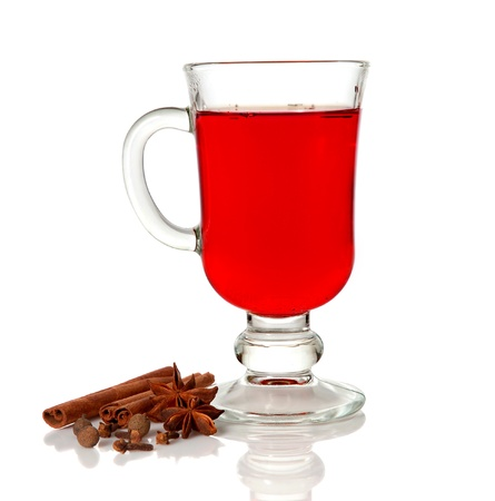 mulled: Hot mulled wine in glass cup and spice on white background Stock Photo