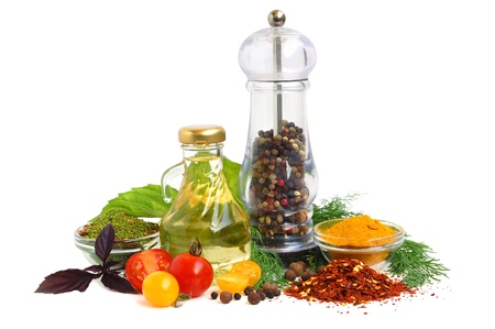 green powder: Cooking oil, pepper shaker, tomato and herb leaves on white background