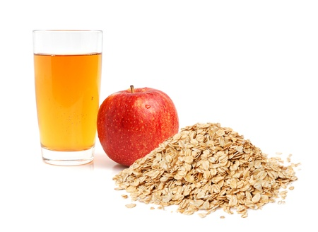 Apple juice, oat flakes and apple on white background Stock Photo - 13414401