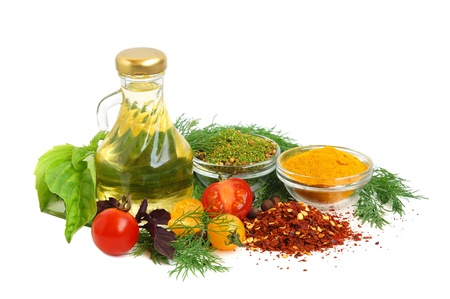 cooking oil: Cooking oil, spice, tomato and herb leaves on white background Stock Photo